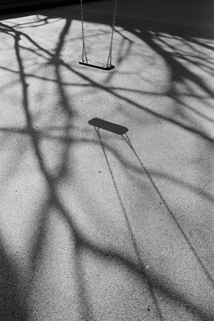 A swing on a playground