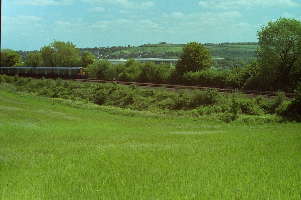 a photograph of a train whizzing through the countryside