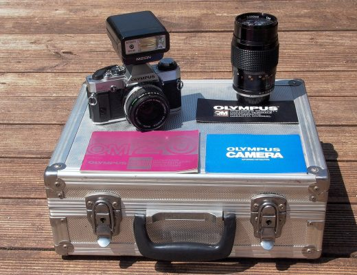 photo of olympus OM20 camera, flash, lens and case
