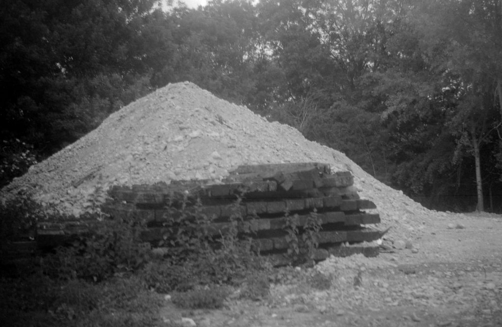 monochrome photograph of old railway sleepers and earth