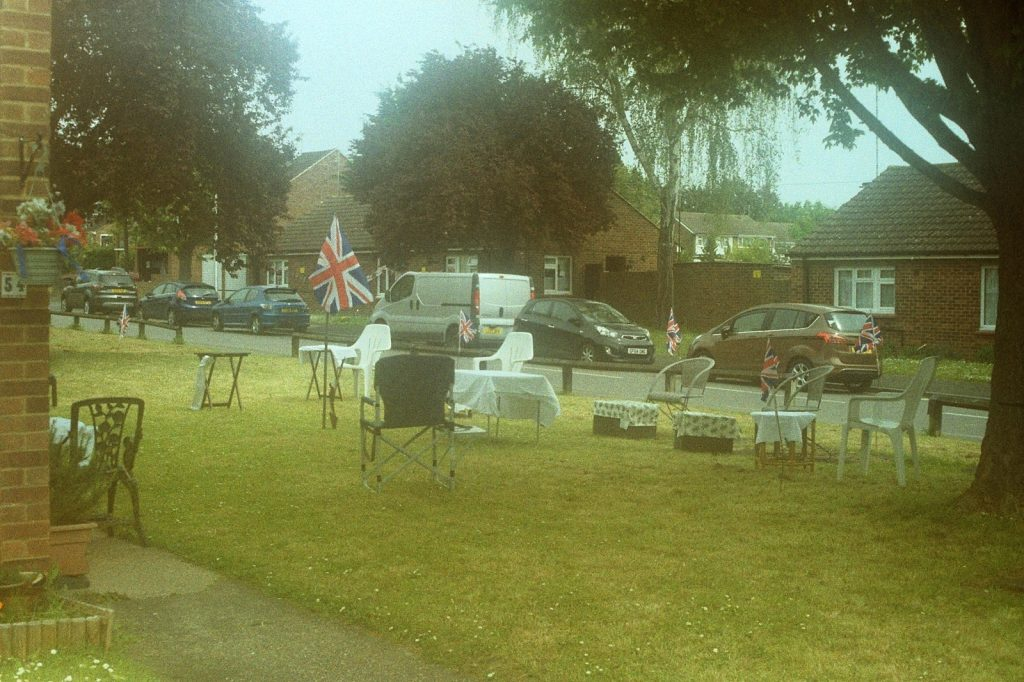 photograph of outside chairs and bunting