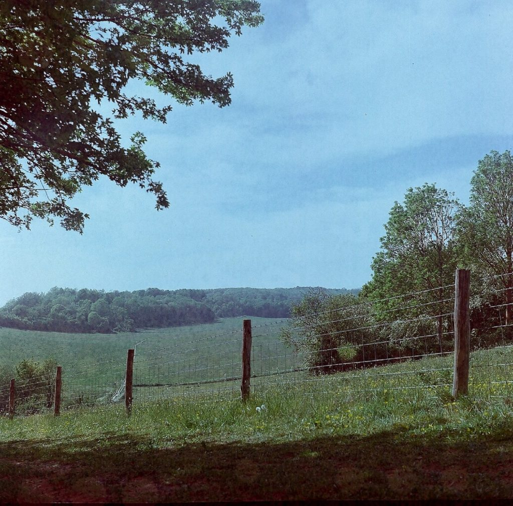 photograph of countryside with fence