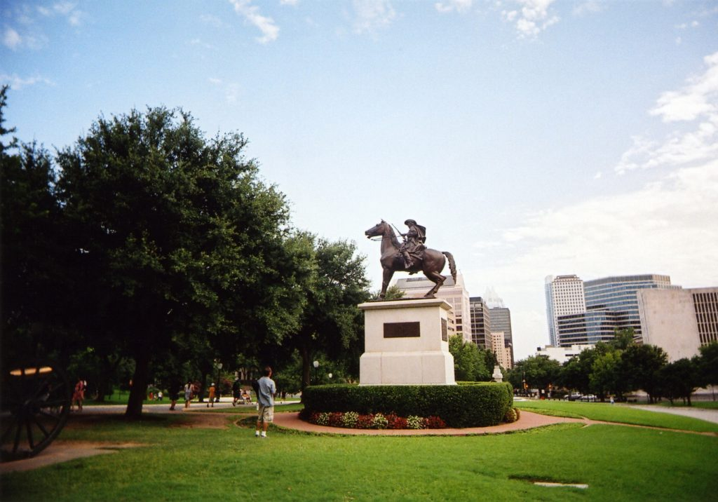 man looking at statue taken with a White Slim Angel ultra wide 35mm point and shoot film camera