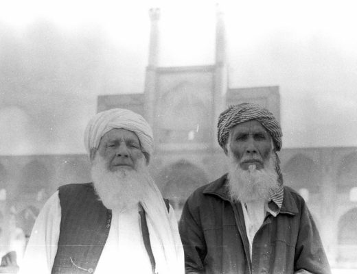 Two old men in front of the Amir Chaghmagh mosque in Yazd