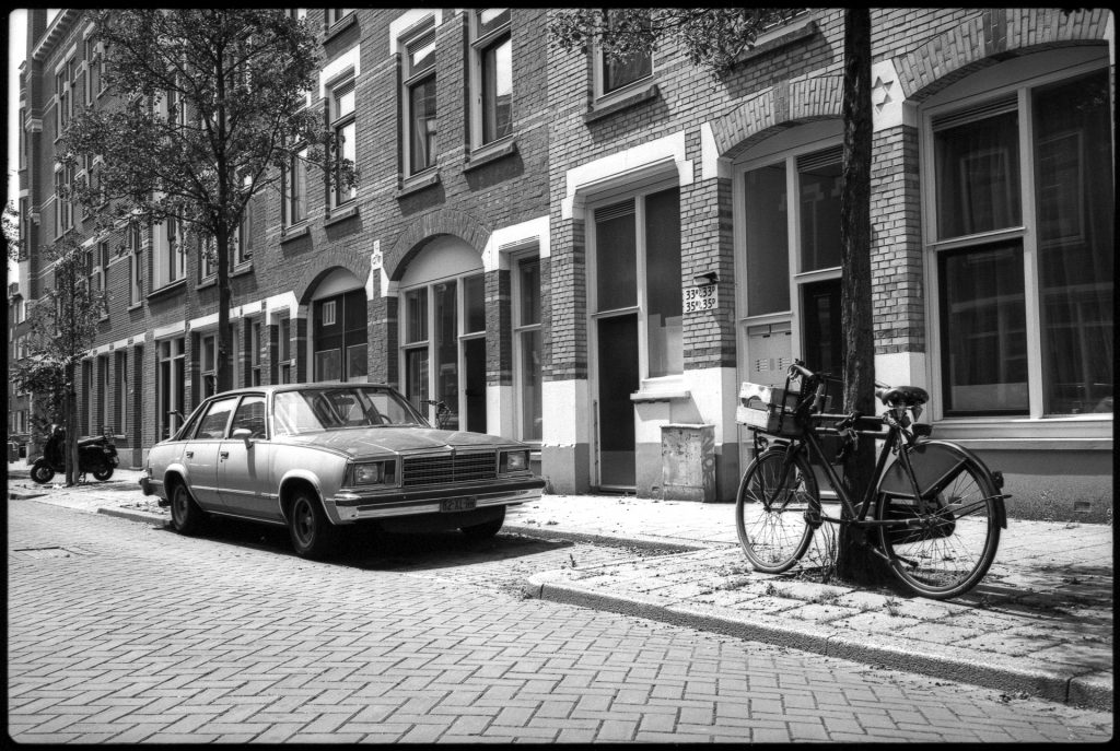 A vintage American car on an old street in Rotterdam