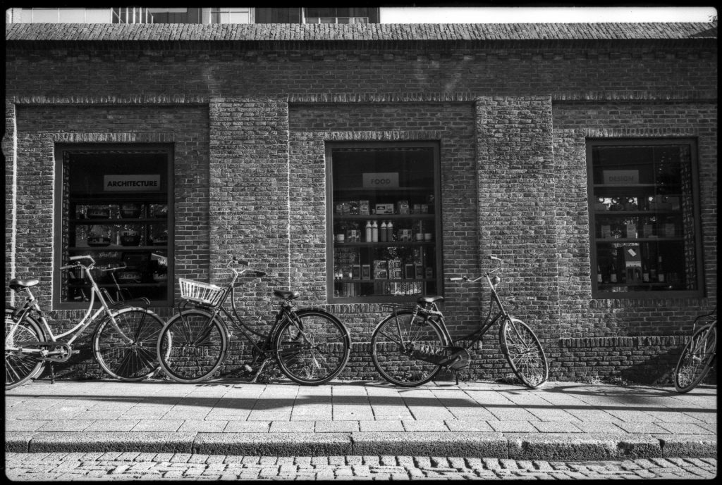 Bicycles parked in front of an old brick building, Rotterdam