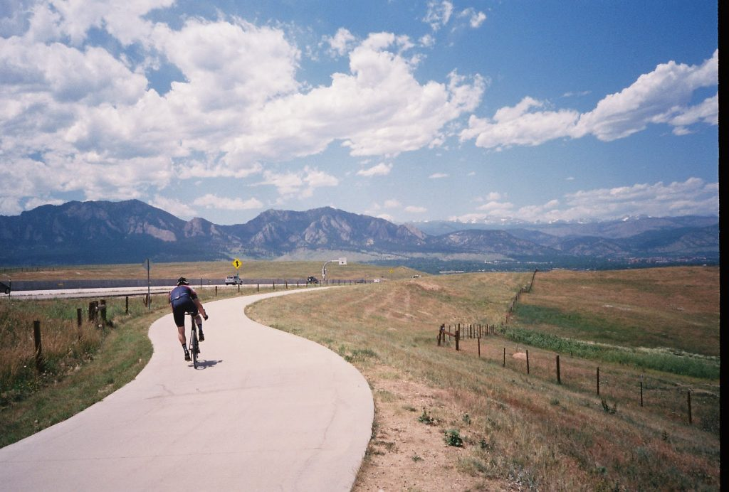 Cyclist looking over the Flatirons
