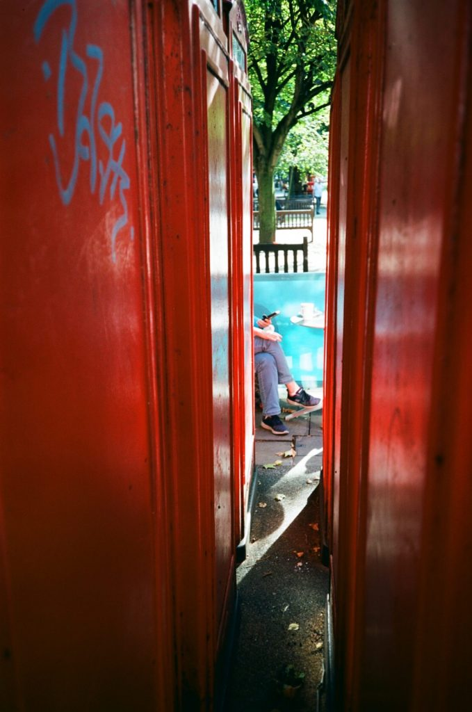 Red phone boxes street photo