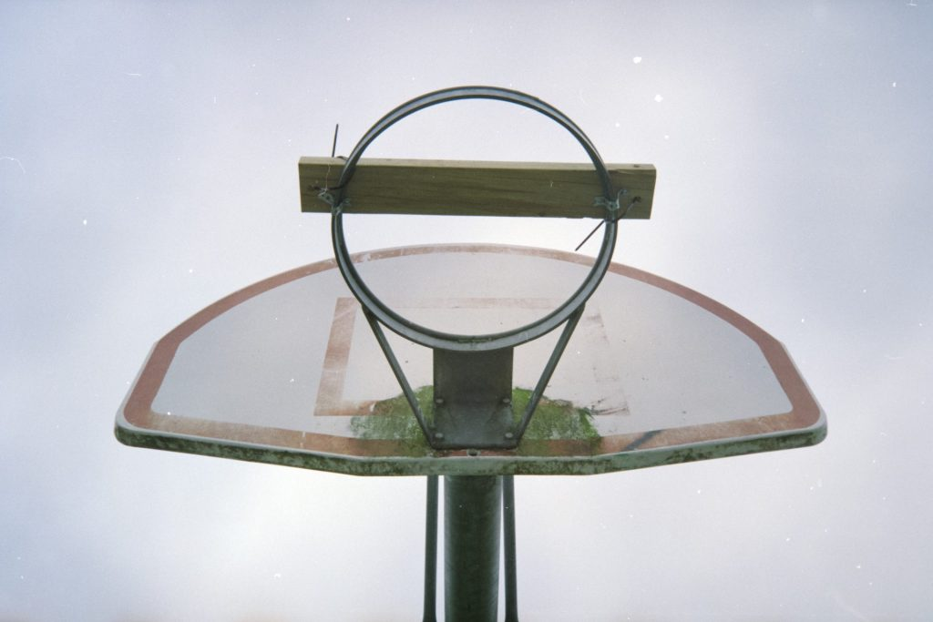 Basketball hoop with piece of wood