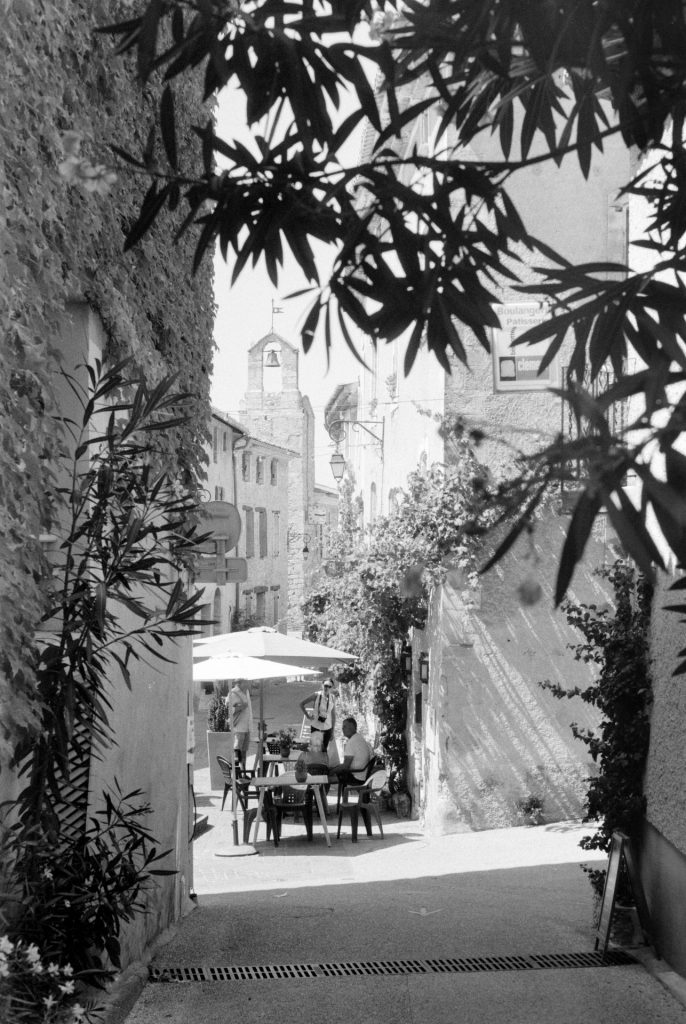 French vilage street with cafe