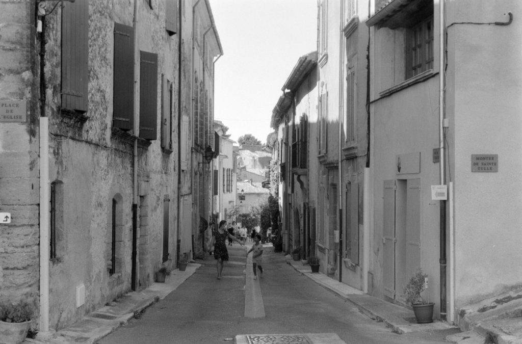 Narrow village street with people