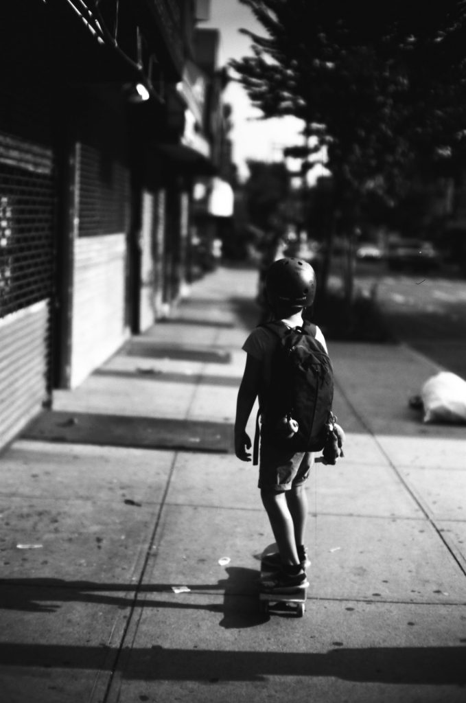 My son returning home on his skateboard.