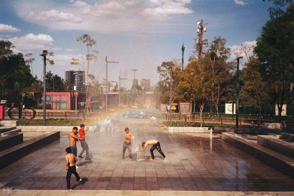 Kids playing with a Water Fountain Rainbow Mexico City 2019