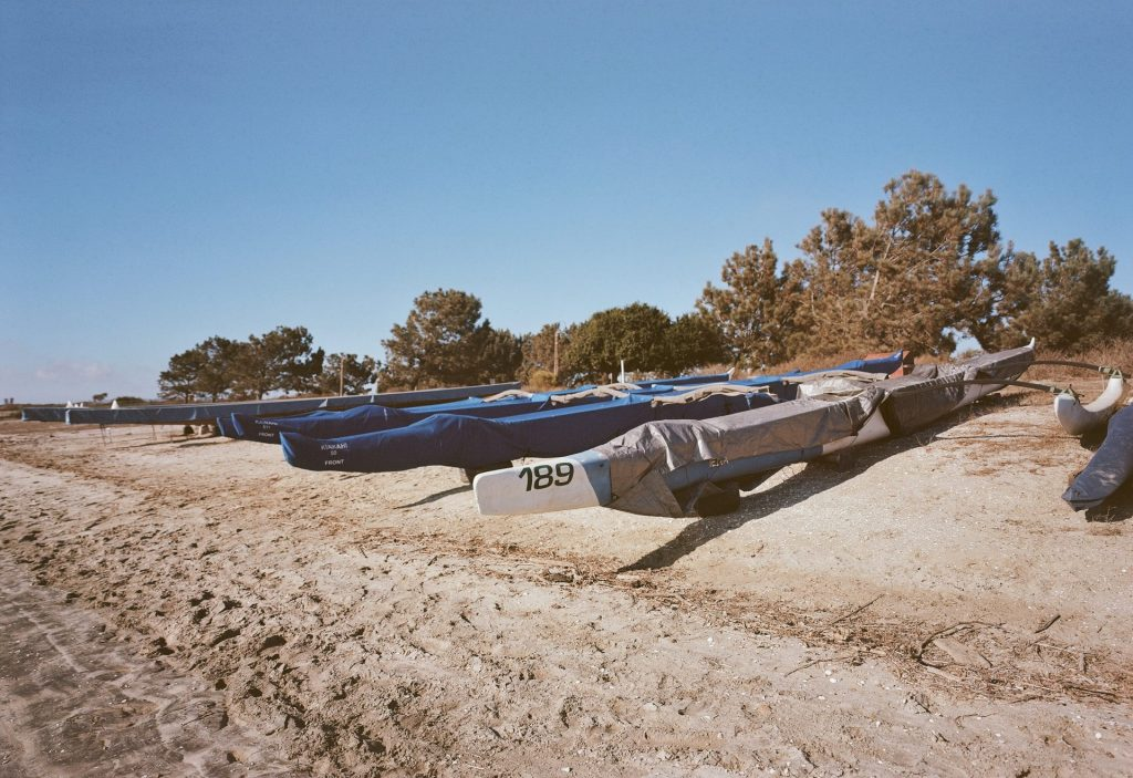 Canoes stored on the beach sand.