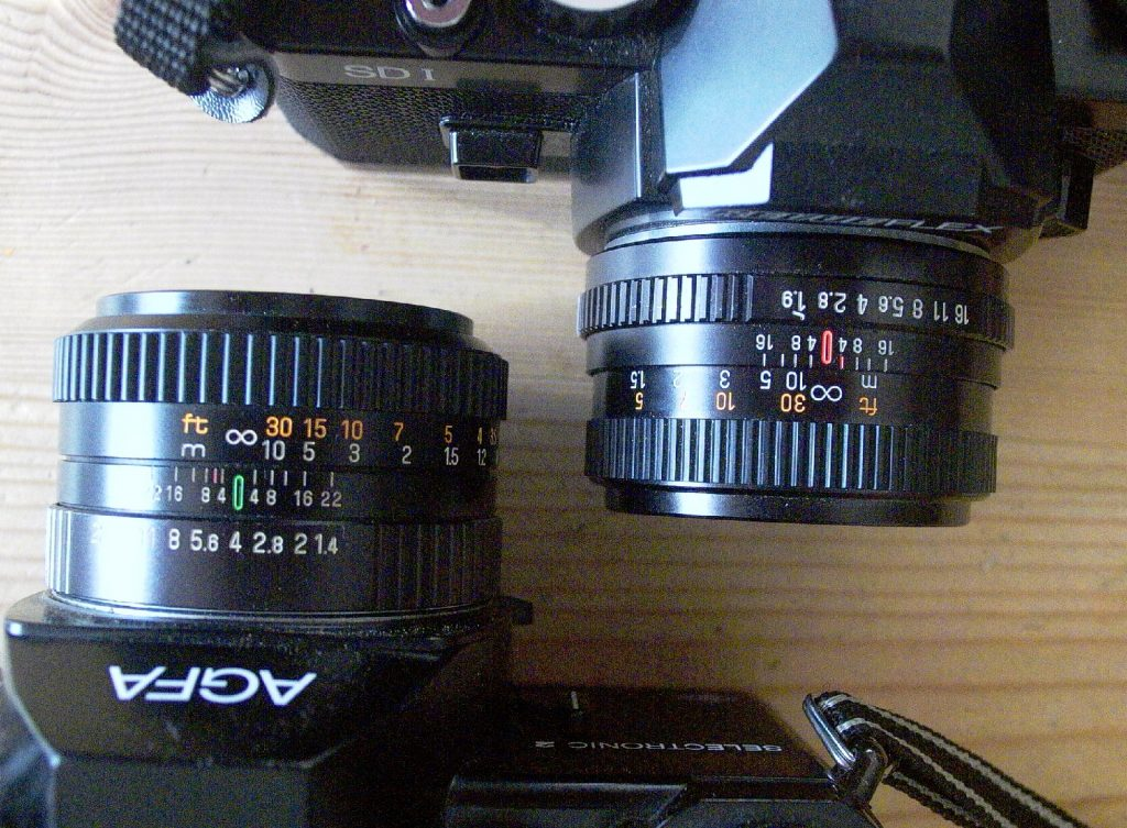 a photo showing two 5omm lenses