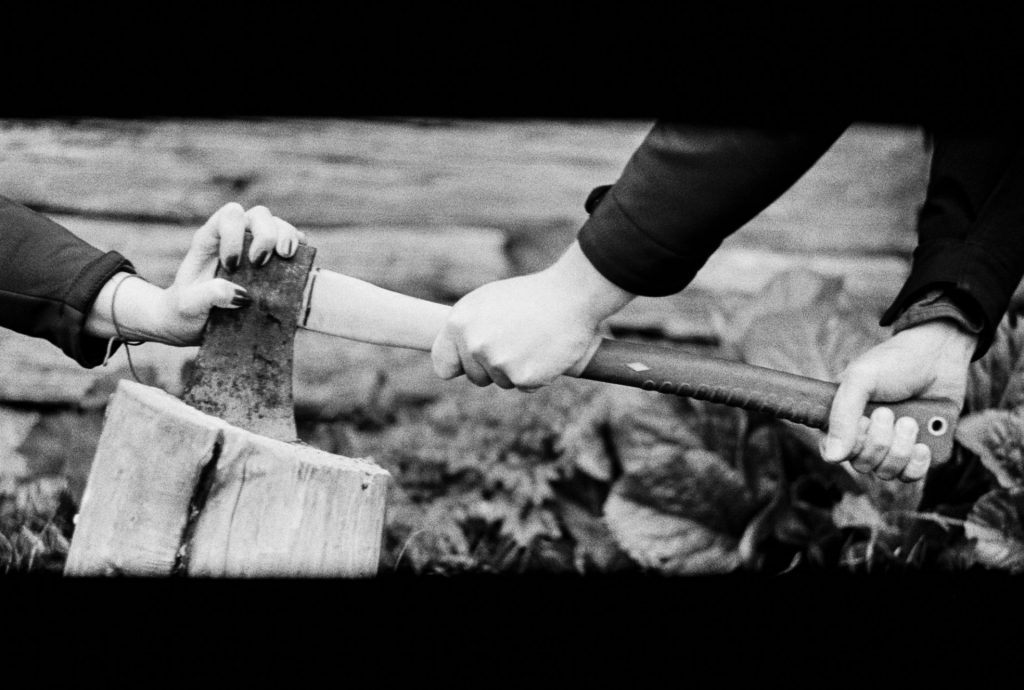 axe with hands on film