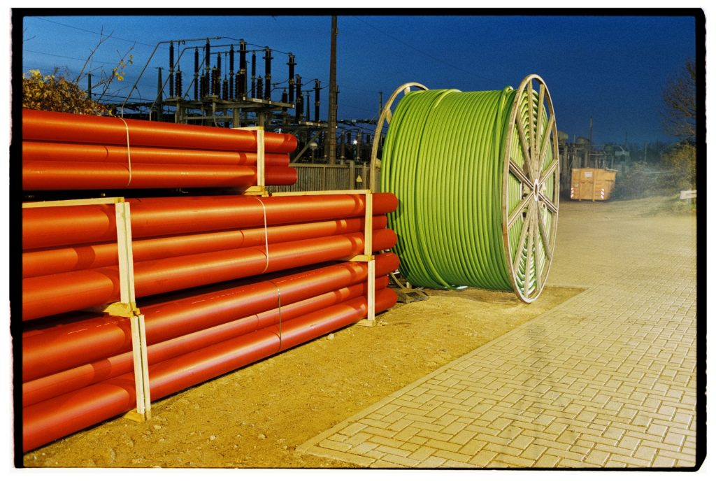 a stack of sewage pipes and a cable drum shot on Fuji Superia 400 film
