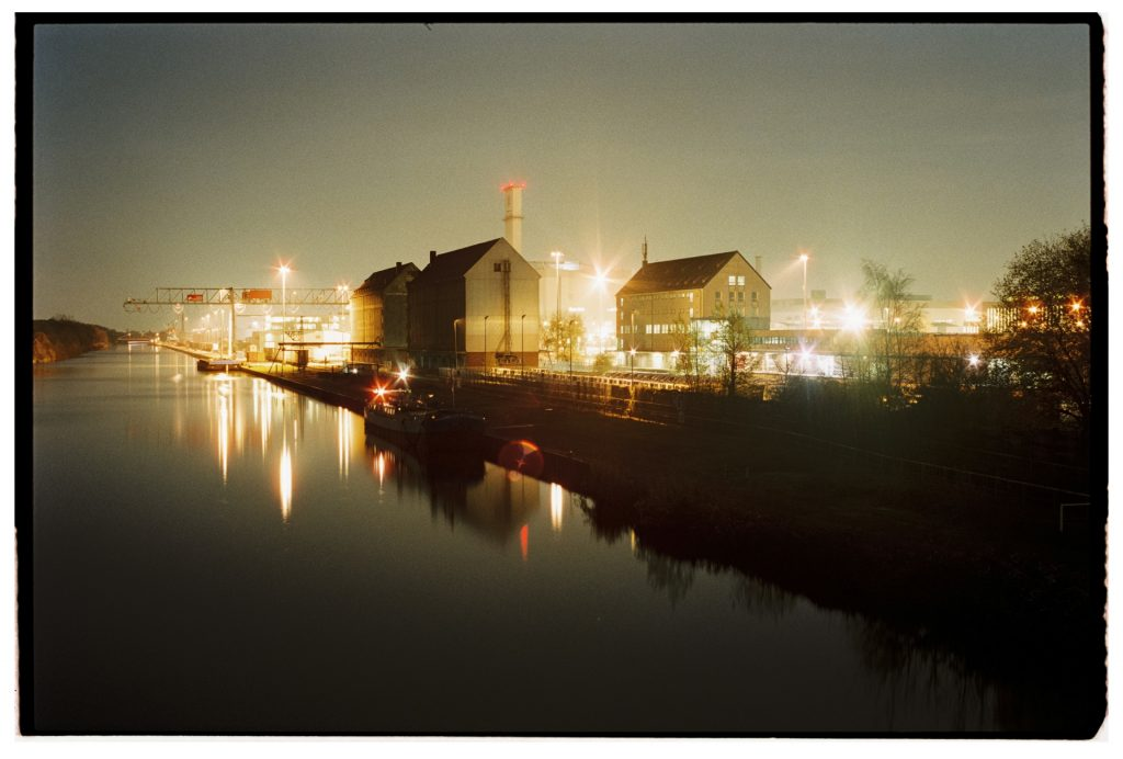 night-time shot of warehouses at Nordhafen inland harbor in Hannover, Germany