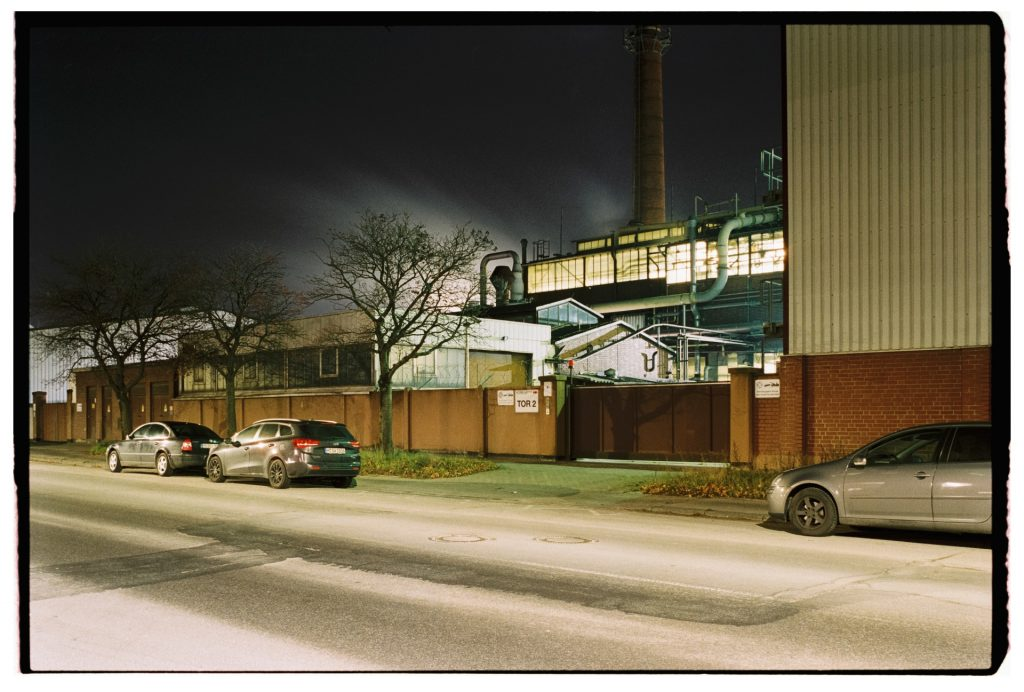 a factory at night, shot on Fuji Superia 400 film