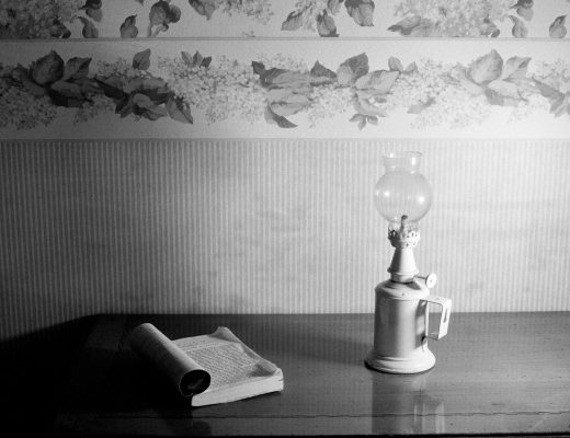book and lamp on table