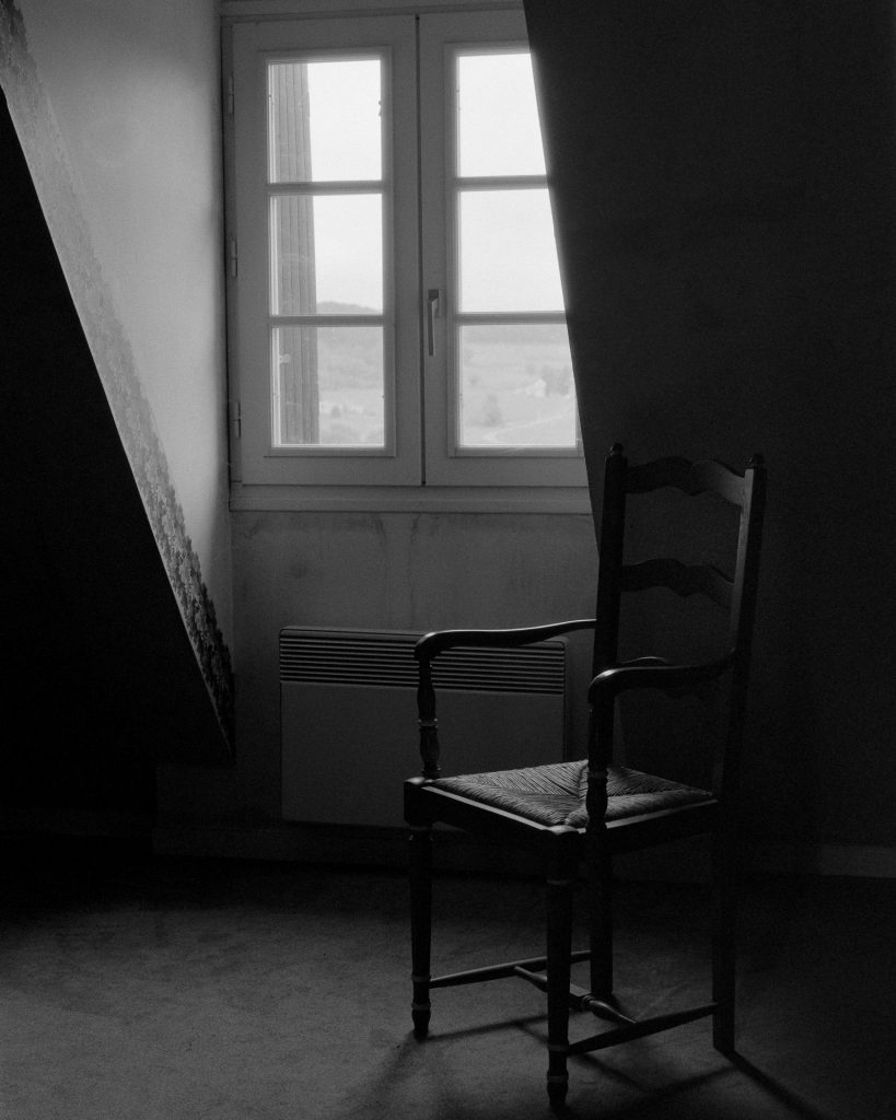 Picture of a window and empty chair
