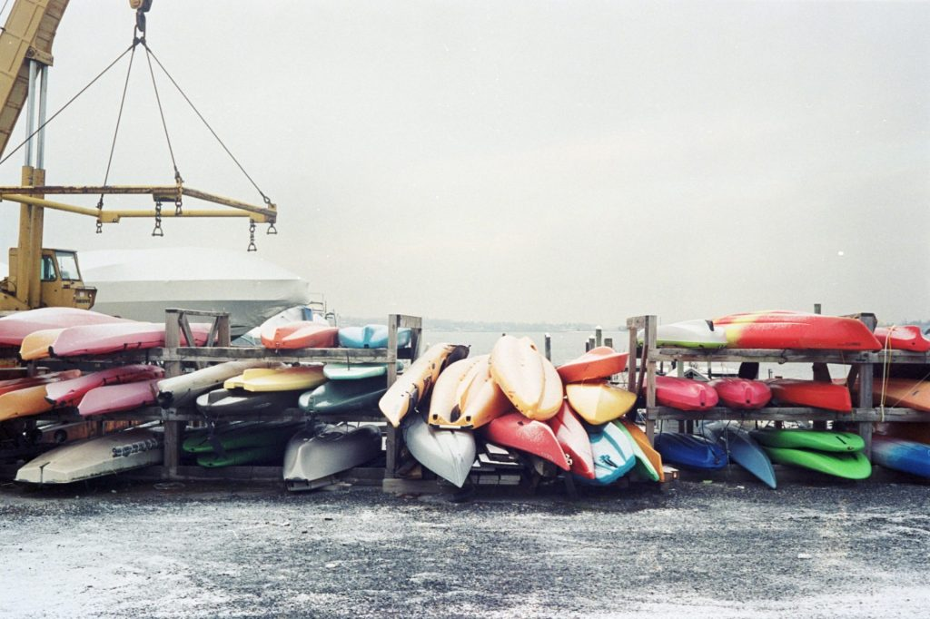 Colorful kayaks and canoes