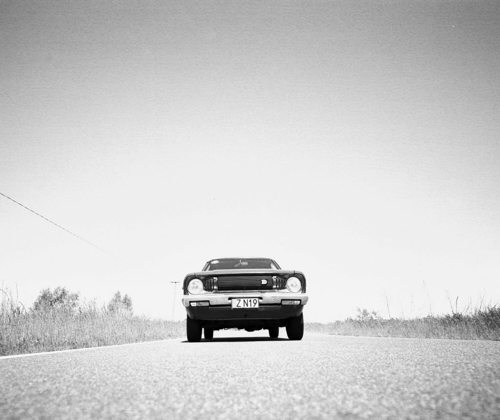 Datsun 120Y shot on Rollei RPX25 with Mamiya 7ii