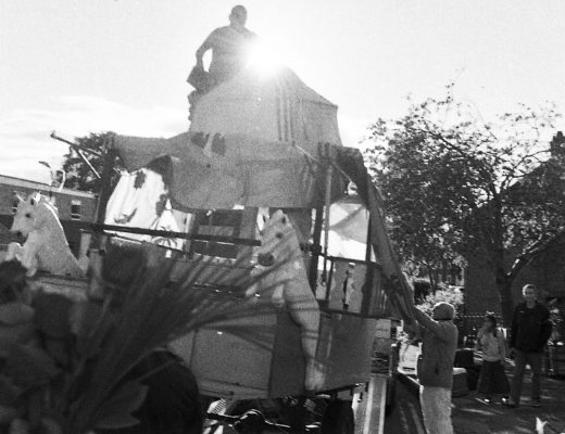 Devotees deconstructing the chariot as the procession concludes.