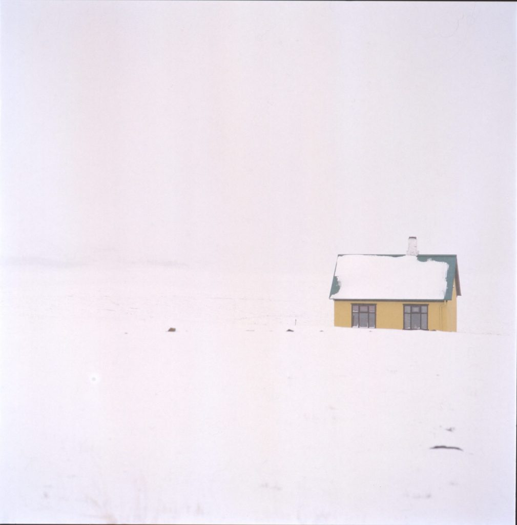 Yellow house in white out