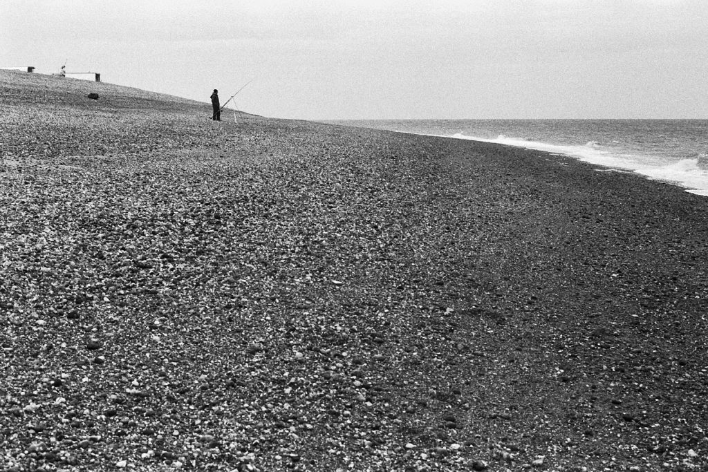 A fisherman on the beach, Dungeness, Kent.
