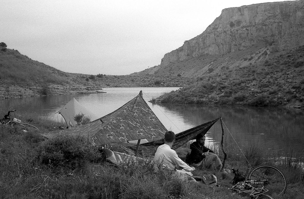 Jonathan and Suly chilling after setting the tarps by the shore of the reservoir