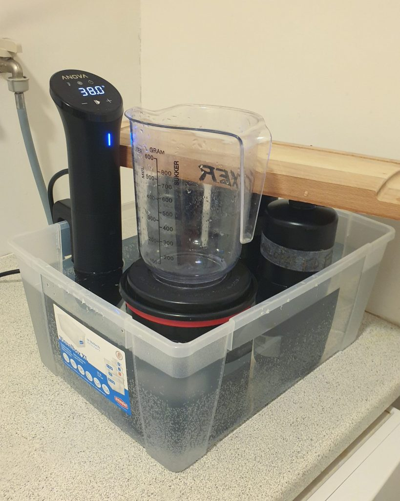 bottles in water, sous vide and film tank with jug on