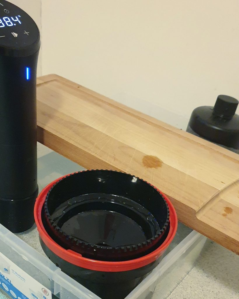 chopping board wedging bottles and tank in water