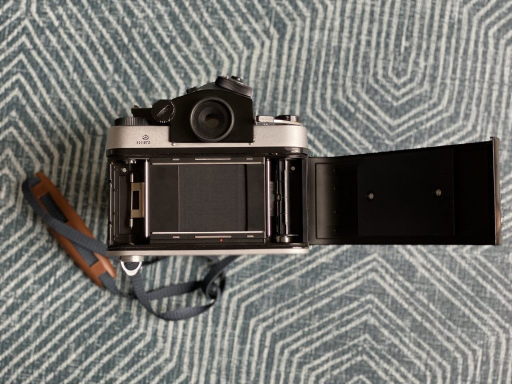Kiev 60 SLR rear view with film loading door open showing focal plane shutter and spools.