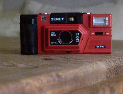 colour photograph of a red compact camera