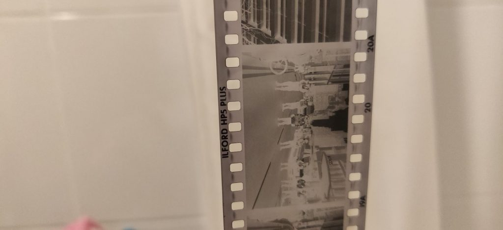 A black and white film negative, showing contrast and density.