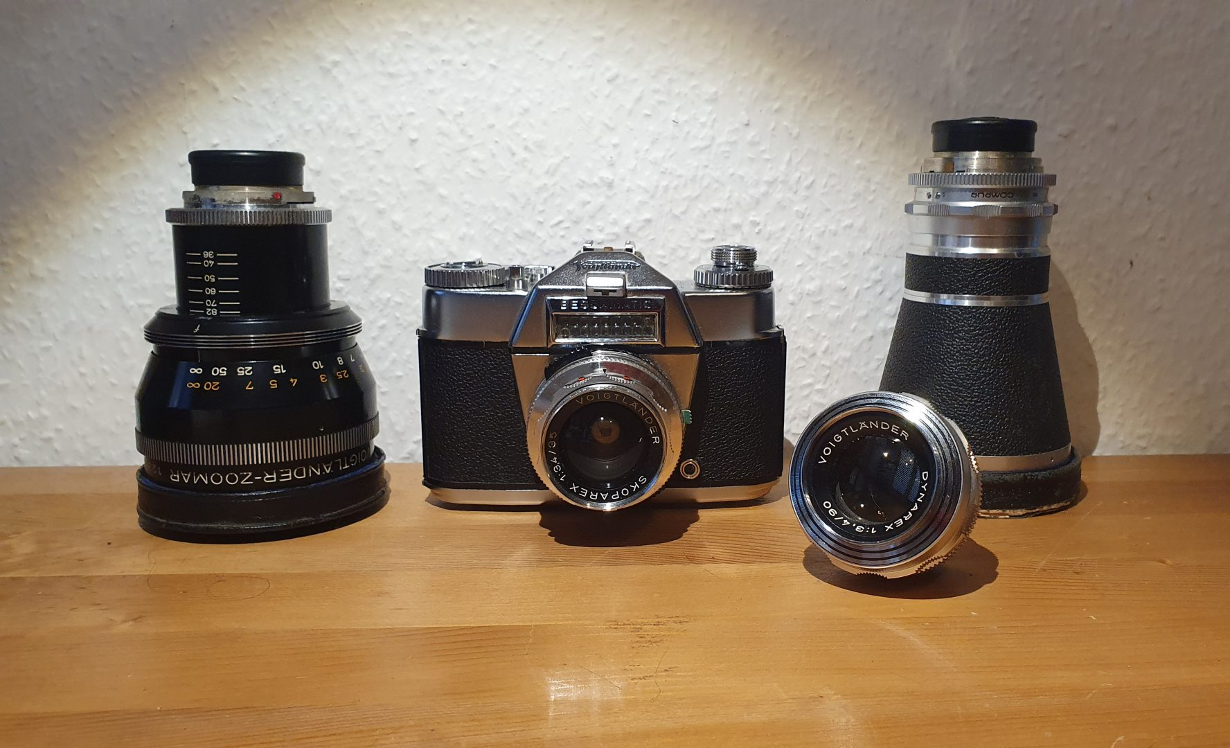 Voigtländer Bessamatic DeLuxe camera surrounded by the 90 mm and the 200 mm as well as the Zoomar 36 - 82 mm lens