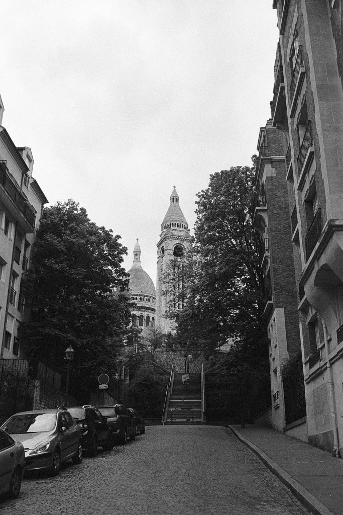 The Montmartre Basilica at the end of a street