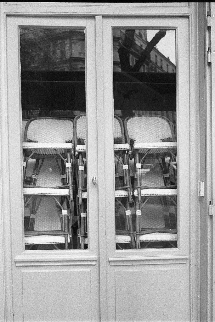 A closed café with chairs behind window