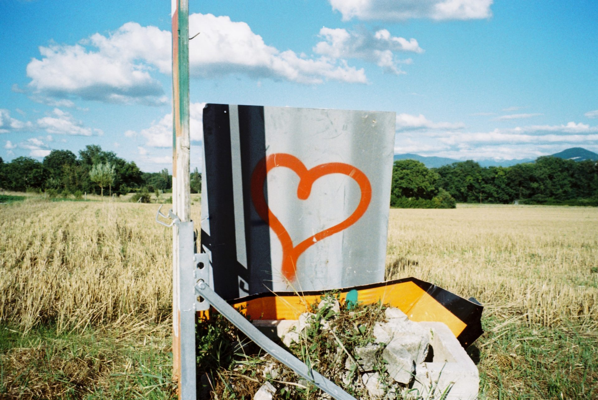 heart sprayed on a sign in the fields
